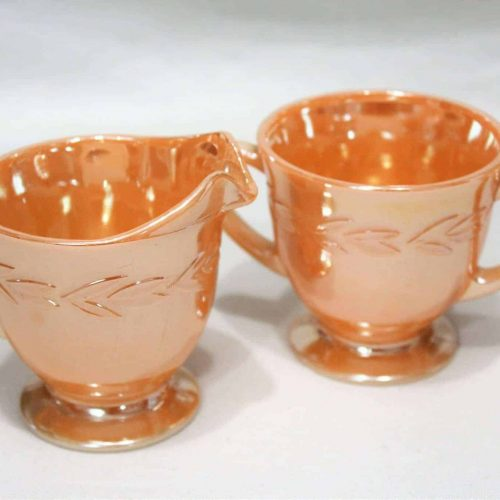 "Creamer and Sugar, Peach Lusterware, Fire King, ""Laurel"", Footed"